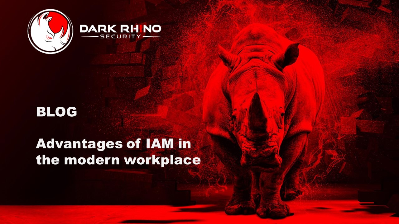 Blog advantages of IAM in the modern workplace with Dark Rhino Security with rhinoceros in red light breaking through a brick wall background